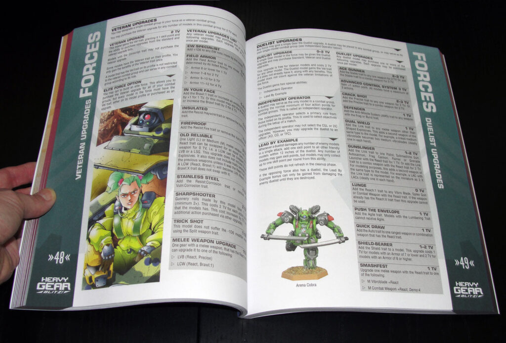 Rulebook page spread showing upgrade options for veteran units